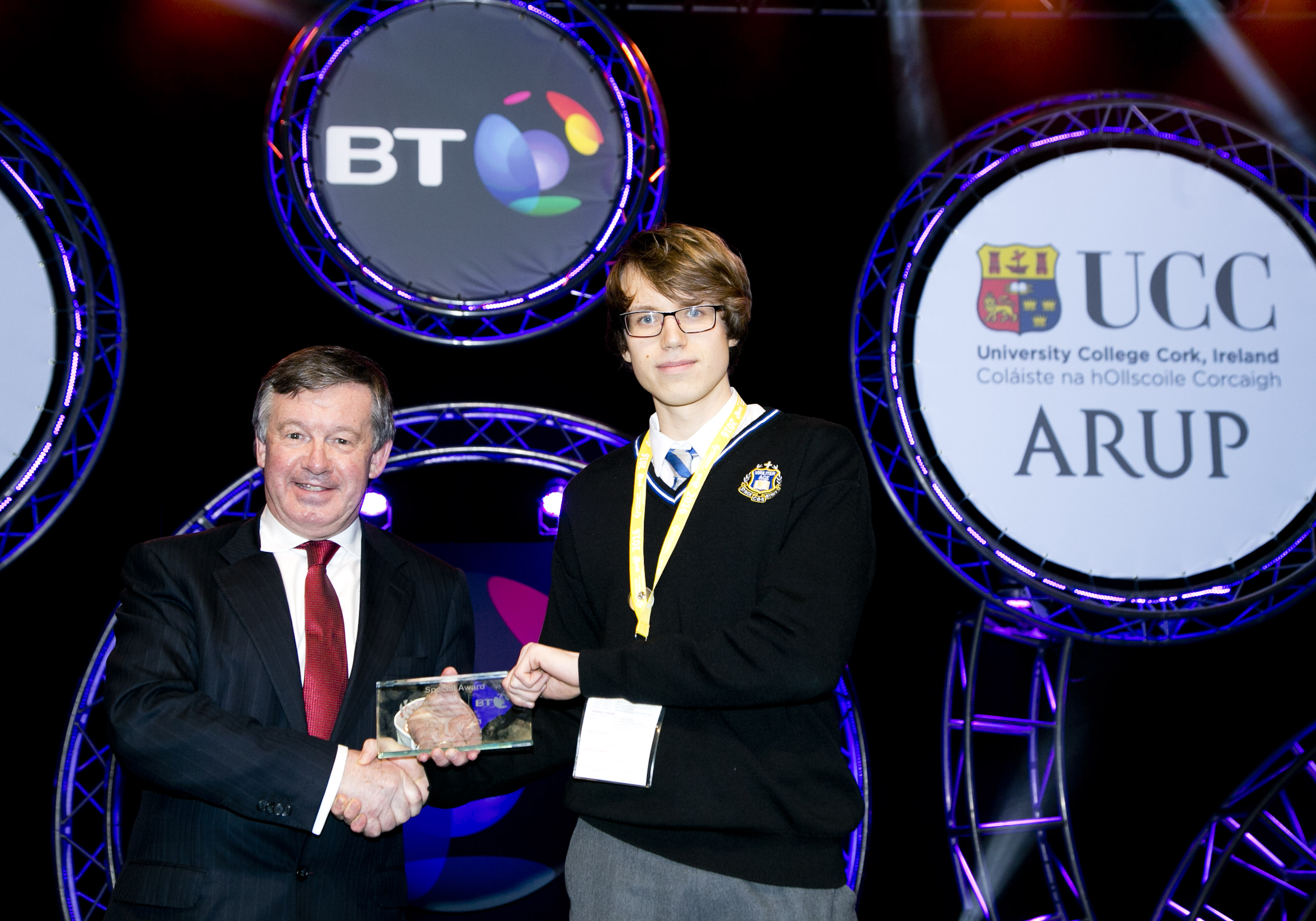 BT Young Scientist and Technology Exhibition 2016, awards evening at the RDS. Prof. Michael Murphy, President UCC who presented  the UCC/ ARUP Award, to Antanas  Murelis from Synge Street, Dublin for his project, 'PricingParison Options Using Monte Carlos Simulation'. Picture Colm Mahady / Fennells