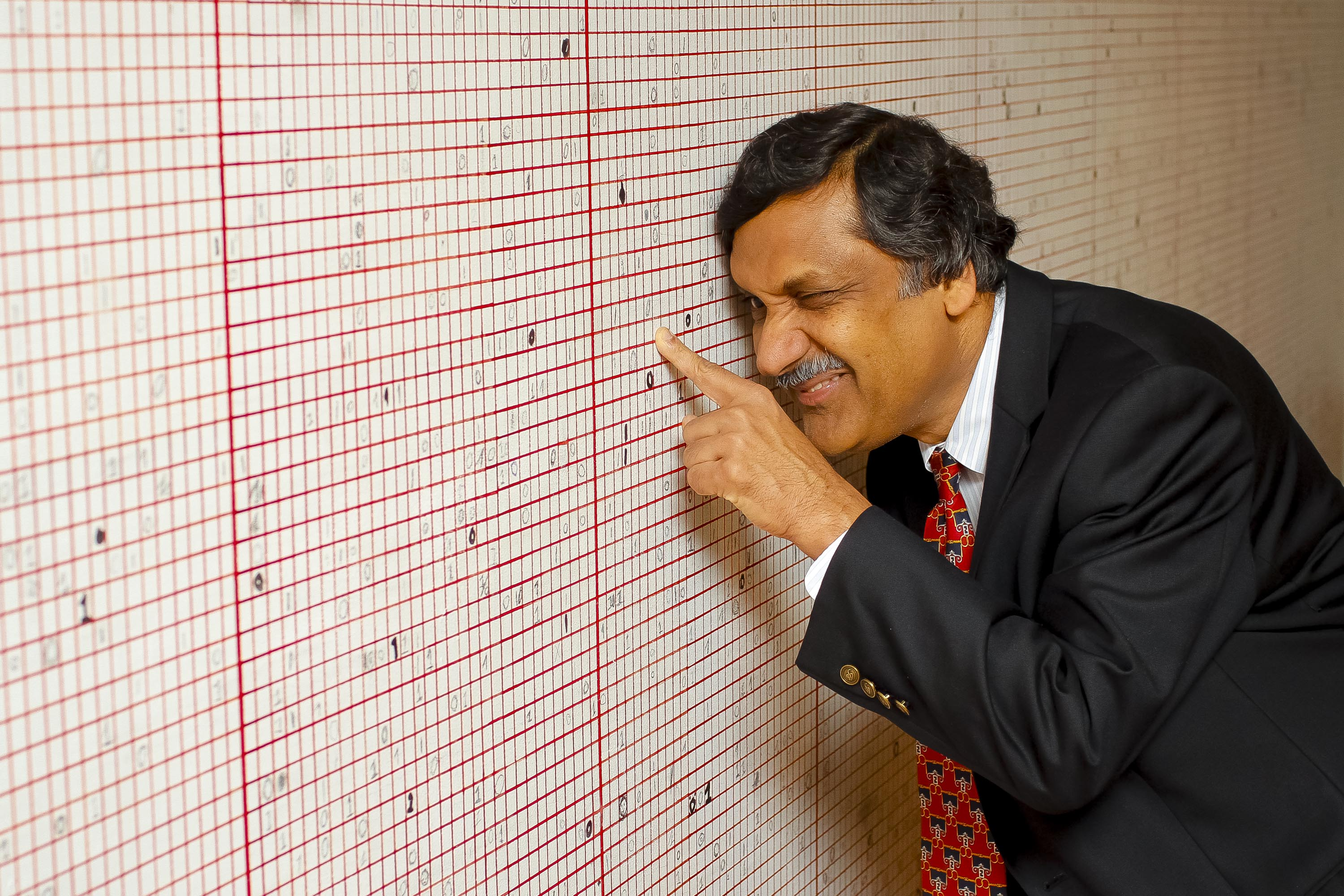 Professor Anant Agarwal, CEO of EdX, adds his mark to the Live Statistics Wall at the Glucksman Gallery.